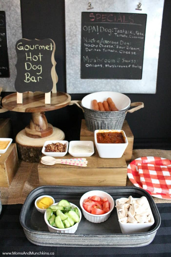 This Gourmet Hot Dog Bar is an easy summer party idea! It's a fun way to serve food at a backyard BBQ party and it's perfect for a camping themed party! Find this Pin and more on Party bar ideas by Mel's Cookbook. Gourmet Hot Dog Bar including ideas for party decorations, recipe ideas, hot dog toppings, and more. This is a great idea for a BBQ.